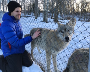 Toby with a wolf. We are very jealous.